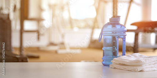Poster de jardin Spa Towels and sport bottle with copy space in the gym
