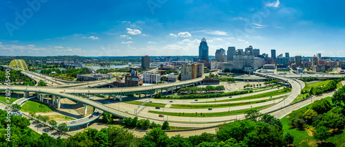 Aerial panoramic view of Cincinnati downtown from the east on a sunny afternoon with twisting highways and bridges
