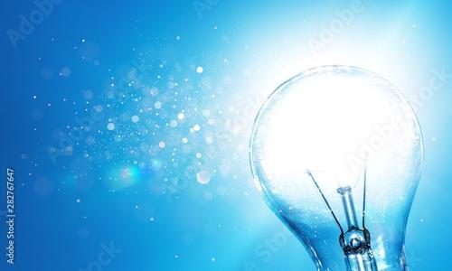Standard Incandescent Light Bulb on Blue Background Wallpaper Mural