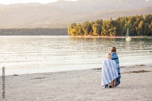 Fototapeta Young boy and girl looking off into distance at Whitefish Lake in Montana obraz