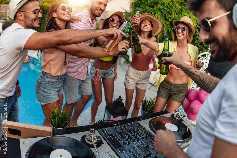 Fototapeta Enjoying pool party with friends