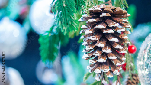 Fotografie, Obraz  Natural Christmas New Year's toy pine cone and Christmas tree branch close-up