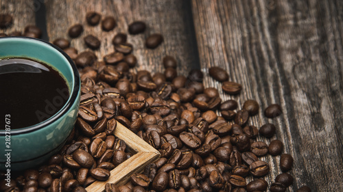 Foto op Aluminium Cafe cup of coffee and beans on brown wooden table with text space