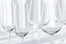Several Glasses For Different Kind Of Wine On The White Tablecloth. Abstract  Background.