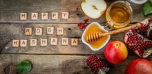 Rosh Hashana Jewish Holiday Concept - Apples, Honey, Pomegranate, Rustic Wood Background