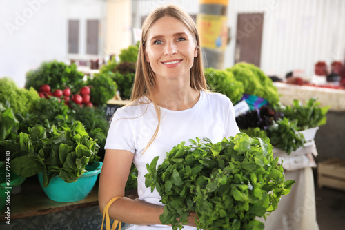 Woman with fresh mint at market