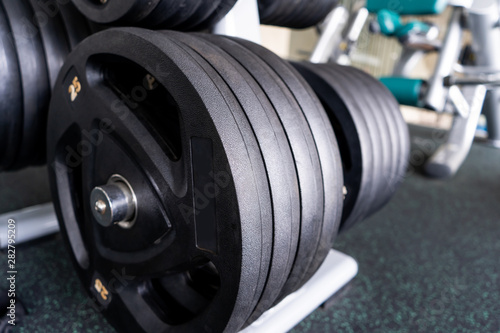 Aluminium Prints F1 Sports equipment in gym Barbells of different weight on rack