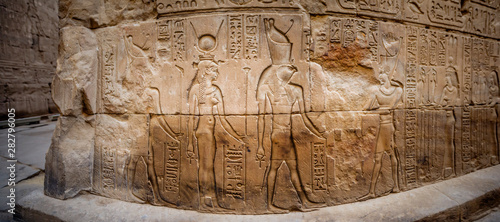 ancient-egyptian-hieroglyphs-and-relief-drawings-on-one-of-the-walls-of-the-edfu-complex-temple-of-edfu-nubia-egypt