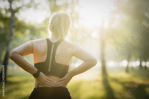 Fotografía  Sport injury. Woman with back pain