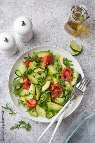 Poster Pierre, Sable avocado, smoked salmon and cucumber salad on white plate