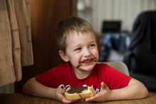 Cute 5 Y.o. Boy Eating  Chocol...