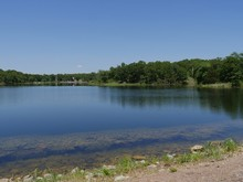 Wide, Side View Shot Of A Lake At Chickasaw National Recreation Area In Davis, Oklahoma
