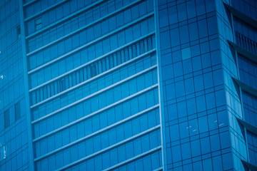 Urban abstract - windowed corner of office building.
