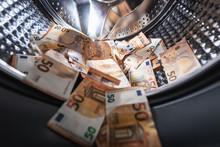 Money Laundering Concept - Euro Banknotes In Washing Mashine