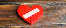 A Red Heart With A Plaster. Renewal Of The Relationship. Family Psychotherapist Services. Reconciliation. Saving The Family. Search For Compromises. Conflict, Dispute Resolution