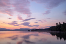 Pink And Purple Sunrise Over Flagstaff Lake In The High Peaks Region Of Western Maine.