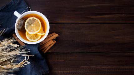Flat lay view of herbal tea with lemon