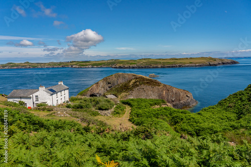 The white farm house and café on Ramsey Island RSPB nature reserve фототапет