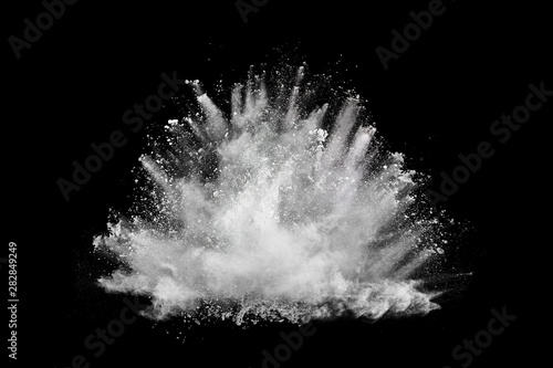 Fototapeta White powder explosion on black background. Colored cloud. Colorful dust explode. Paint Holi. obraz
