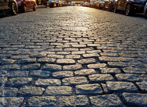 Obraz Sunlight shines on the cobblestones of Harrison Street in the Tribeca neighborhood of Manhattan in New York City - fototapety do salonu