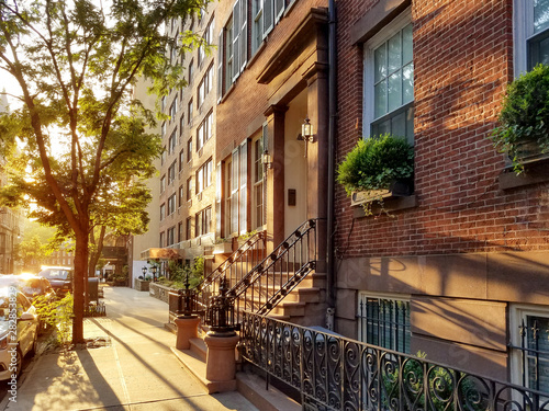 Old brownstone buildings along a quiet neighborhood street in Greenwich Village, New York City - 282853829
