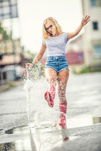 Cheerful Girl Jumping With Whi...