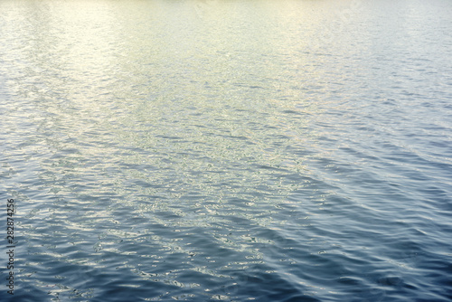 Valokuva  Water surface with ripples and sunlight reflections