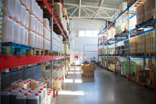 Chemical Production.Warehouse With Shelves, Plastic Cans.