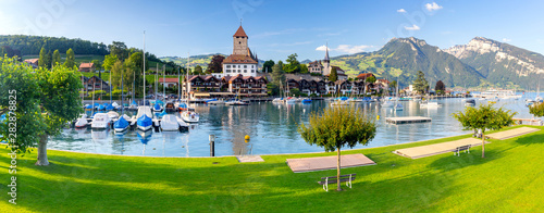 Panorama of the traditional alpine village Spiez near Lake Thun. Canvas Print