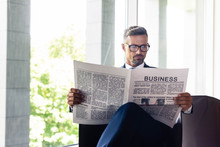 Handsome Businessman In Suit And Glasses Reading Newspaper Business