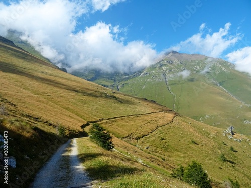 Fotografija Nature, meadows and peaks that characterize the landscape of the Italian Alps in Val di Susa, near the village of Susa, Piedmont - August 2019