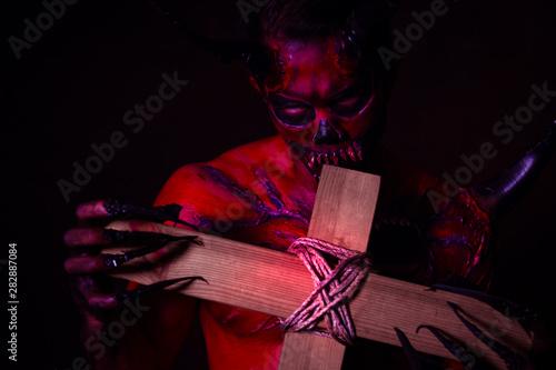 Bad devil or monster bite the cross on halloween day Canvas Print