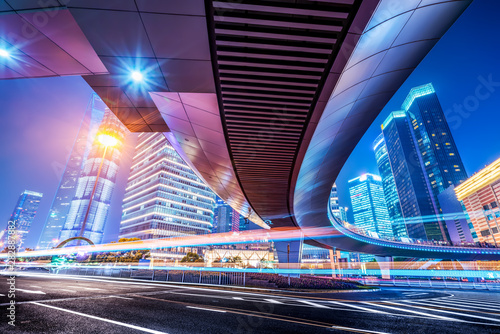 Foto op Aluminium Shanghai the light trails on the modern building background