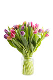Fototapeta Tulipany - Bouquet of spring tulips flowers in a transparent glass jar isolated on white
