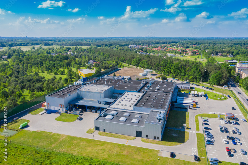 Fototapeta Aerial drone view on distribution center. Logistic and transport concept