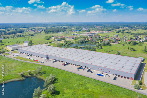 Vászonkép  Aerial view of the distribution center, drone photography of the industrial logi