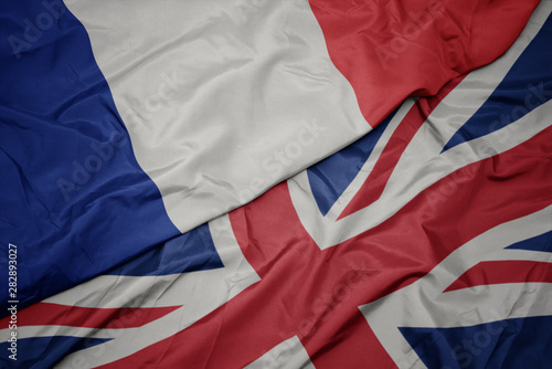 Wall Murals Northern Europe waving colorful flag of great britain and national flag of france.