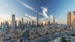 Dubai Downtown skyline day to night timelapse with Burj Khalifa and other towers paniramic view from the top in Dubai