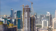 Construction Activity In Dubai Downtown With Cranes And Workers Timelapse, UAE.