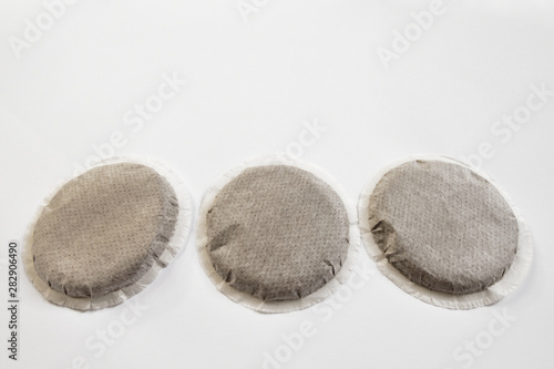 Fotomural Eco friendly coffee pods filled with ground filter coffee, copy space for text and design
