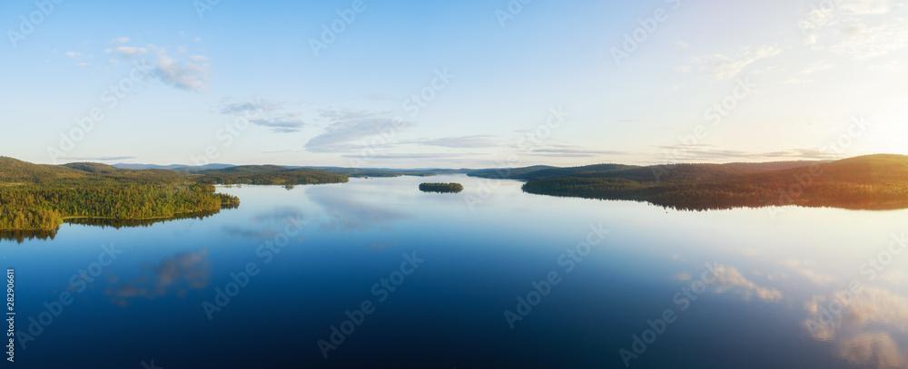 Fototapeta Aerial panorama of beautiful lake Inari, islands and green forest at sunset. Inarijarvi,Lapland