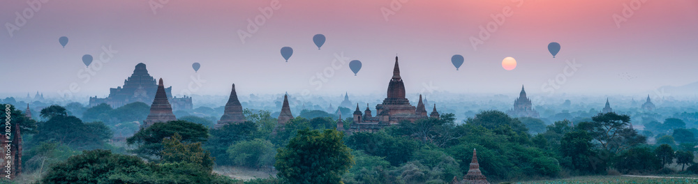 Fototapeta Bagan panorama with temples and hot air-ballons during sunrise
