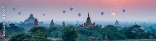 Poster Sunset Bagan panorama with temples and hot air-ballons during sunrise