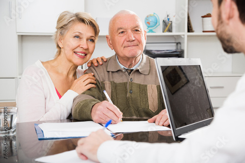 Photo  Old man and woman in social department