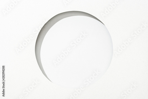cut out round hole in white paper on white simple background