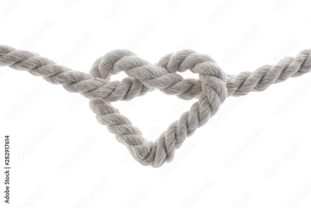 Fototapeta heart shape knot of rope isolated on white background