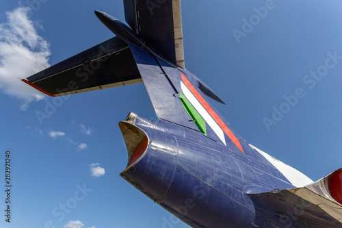 Militaire Tail of an old russian airplane on a summer day