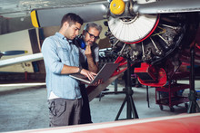 Engineer Looking At Laptop For Maintenance An Airplane