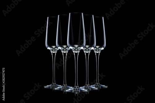 Set of empty luxury champagne glasses in a row isolated on a black background