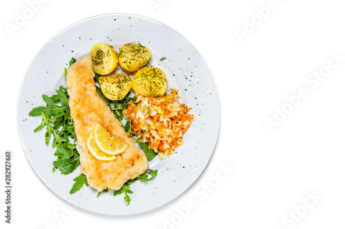 Photo Fish dish - fried fish fillet boiled potatoes and vegetables